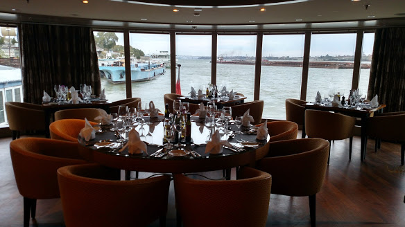 AmaWaterways Chef's Table has a few tables beautifully arranged for fine dining with floor to ceiling windows and a stunning view of the river.